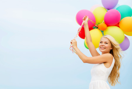Foto de summer holidays, celebration and lifestyle concept - beautiful woman with colorful balloons outside - Imagen libre de derechos