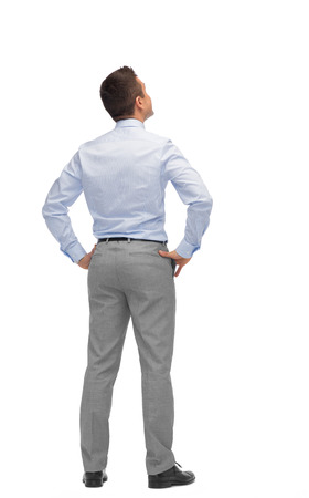 Photo pour business, people, rear view and office concept - businessman looking up from back - image libre de droit