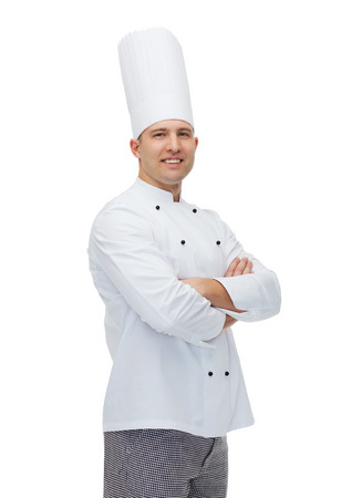 Foto per cooking, profession and people concept - happy male chef cook with crossed hands - Immagine Royalty Free