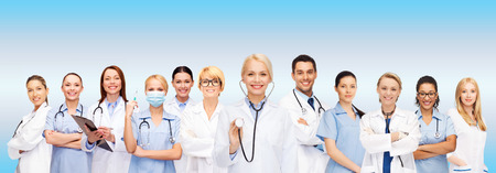 Foto de medicine and healthcare concept - team or group of female doctors and nurses - Imagen libre de derechos
