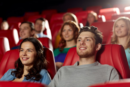 Photo for cinema, entertainment and people concept - happy friends watching movie in theater - Royalty Free Image