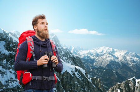 Foto de adventure, travel, tourism, hike and people concept - man with red backpack and binocular over alpine mountains background - Imagen libre de derechos