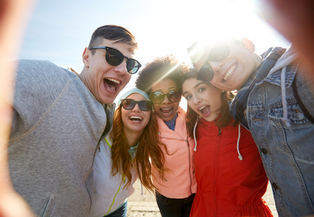 Photo for tourism, travel, people, leisure and technology concept - group of happy laughing teenage friends taking selfie outdoors - Royalty Free Image