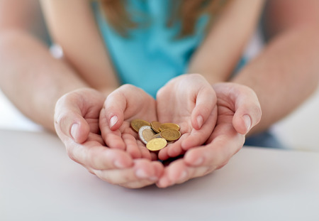 Photo pour family, children, money, investments and people concept - close up of father and daughter hands holding euro money coins - image libre de droit