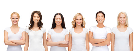 Foto de clothing design and people unity concept - group of happy smiling women in blank white t-shirts - Imagen libre de derechos