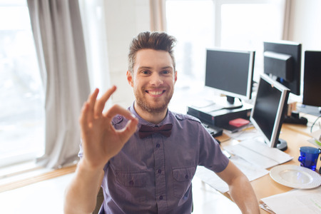 Foto de business, startup, gesture and people concept - happy businessman or creative male office worker with computers showing ok hand sign - Imagen libre de derechos