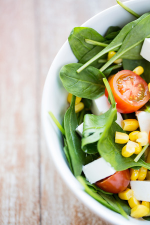 Photo pour healthy eating, dieting, vegetarian kitchen and cooking concept - close up of vegetable salad bowl at home - image libre de droit