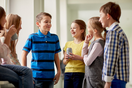 Photo for education, elementary school, drinks, children and people concept - group of school kids with soda cans talking in corridor - Royalty Free Image