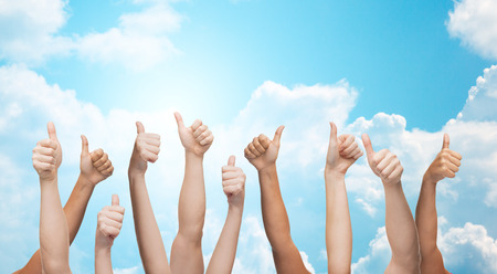 Photo pour gesture, people, human race and international society concept - human hands showing thumbs up over blue sky and white clouds background - image libre de droit