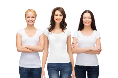 Foto de clothing design and people unity concept - group of happy smiling women in blank white t-shirts and jeans - Imagen libre de derechos