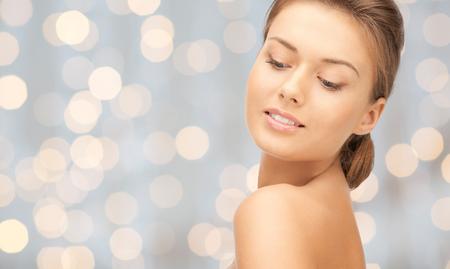 Foto de beauty, people, holidays, luxury and health concept - beautiful young woman face over lights background - Imagen libre de derechos
