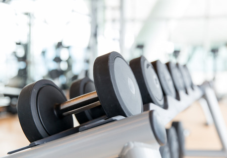 Foto de sport, fitness, weightlifting and health care concept - close up of dumbbells in gym - Imagen libre de derechos