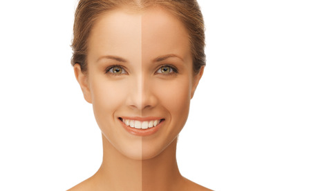 Foto de beautiful woman with half face tanned - Imagen libre de derechos