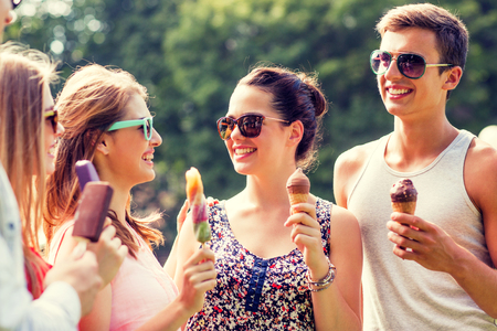 Photo for group of smiling friends with ice cream outdoors - Royalty Free Image