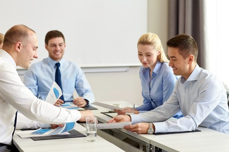 Photo for business, people and teamwork concept - smiling business team with papers meeting in office - Royalty Free Image