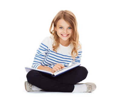 Photo for education and school concept - little student girl sitting on floor and reading book - Royalty Free Image