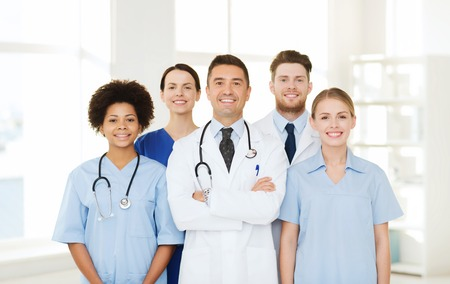 Photo pour hospital, profession, people and medicine concept - group of happy doctors at hospital - image libre de droit