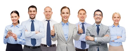 business, people, corporate, teamwork and office concept - group of happy businesspeople showing thumbs up