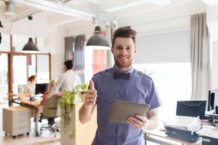 Foto de business, startup and people concept - happy businessman or creative male office worker with tablet pc computer - Imagen libre de derechos