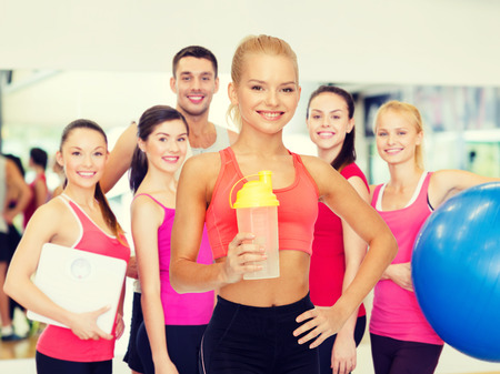 Photo for sport, fitness and diet concept - smiling sporty woman with protein shake bottle - Royalty Free Image