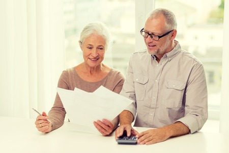 Foto de family, business, savings, age and people concept - smiling senior couple with papers and calculator at home - Imagen libre de derechos