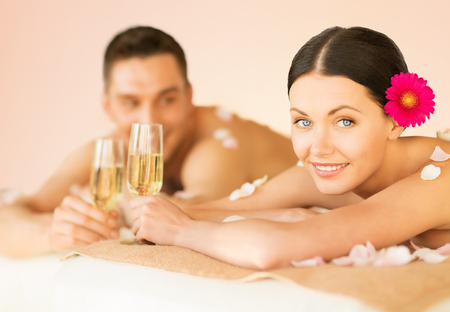 Foto de picture of couple in spa salon drinking champagne - Imagen libre de derechos