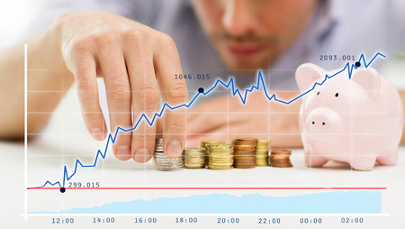 Photo pour business, people, finances and money saving concept - close up of businessman with piggy bank and coins over growing chart - image libre de droit