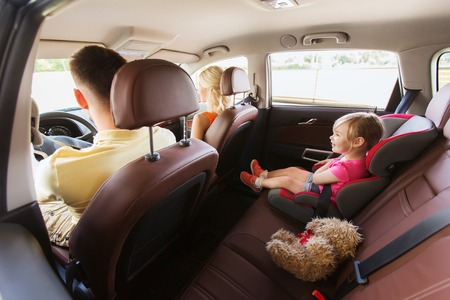 Photo pour family, transport, safety, road trip and people concept - happy parents with little child driving in car - image libre de droit