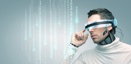 Foto de people, technology, future and progress - man with futuristic 3d glasses and microchip implant or sensors over gray background over binary system code - Imagen libre de derechos