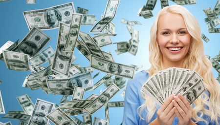 Foto de business, money, finance, people and banking concept - smiling businesswoman with dollar cash money over blue background - Imagen libre de derechos