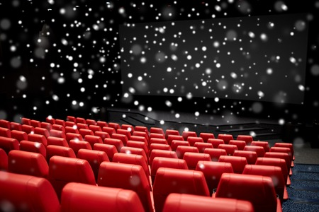 Photo for entertainment and leisure concept - movie theater or cinema empty auditorium with red seats over snowflakes - Royalty Free Image