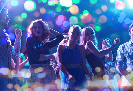 Photo for party, holidays, celebration, nightlife and people concept - group of happy friends dancing in night club - Royalty Free Image