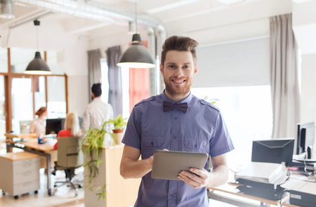 Foto de business, startup and people concept - happy businessman or creative male office worker with tablet pc computer - Imagen libre de derechos