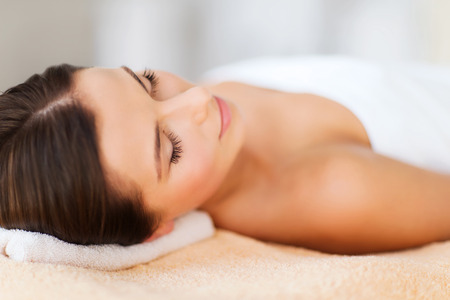 Photo for beauty and spa concept - beautiful woman in spa salon lying on the massage desk - Royalty Free Image