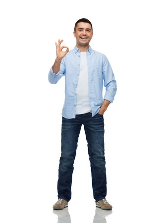 Photo for happiness, gesture and people concept - smiling man showing ok hand sign - Royalty Free Image