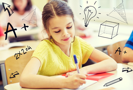 Photo pour group of school kids with notebooks writing test in classroom over doodles - image libre de droit