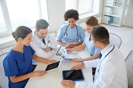 Photo for hospital, medical education, health care, people and medicine concept - group of happy doctors with tablet pc computers meeting at medical office - Royalty Free Image