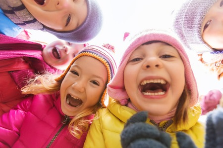 Photo for childhood, leisure, friendship and people concept - group of happy children faces in circle - Royalty Free Image