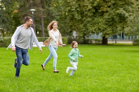 Photo for family, parenthood, leisure and people concept - happy mother, father and little girl running and playing catch game in summer park - Royalty Free Image