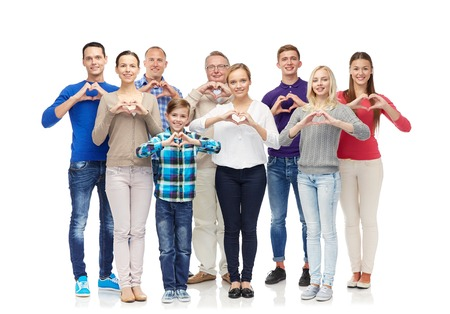 Photo pour gesture, family, generation and people concept - group of smiling men, women and boy showing heart shape hand sign - image libre de droit