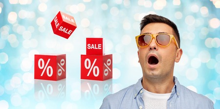 Photo for emotions, shopping, sale, discount and people concept - face of scared or surprised middle aged latin man in shirt and sunglasses over blue holidays lights and red percentage signs background - Royalty Free Image