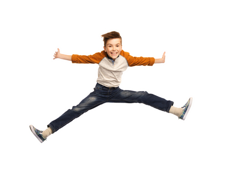 Photo for happiness, childhood, freedom, movement and people concept - happy smiling boy jumping in air - Royalty Free Image