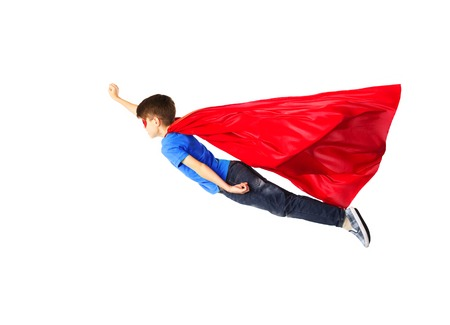 Foto de happiness, freedom, childhood, movement and people concept - boy in red superhero cape and mask flying in air - Imagen libre de derechos