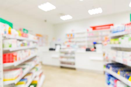 Foto de medicine, pharmacy, health care and pharmacology concept - pharmacy or drugstore room blurred background - Imagen libre de derechos