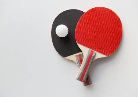 Foto de sport, fitness, healthy lifestyle and objects concept - close up of  table tennis rackets with ball - Imagen libre de derechos
