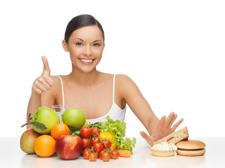 Photo for picture of woman with fruits showing thumbs up - Royalty Free Image