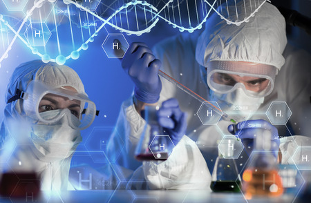 Foto de science, chemistry, biology, medicine and people concept - close up of scientists with pipette and flasks making test in clinical laboratory over hydrogen chemical formula and dna molecule structure - Imagen libre de derechos