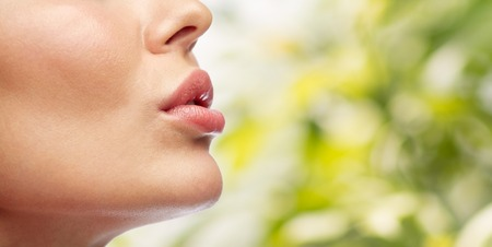 Photo for beauty, people, make-up and plastic surgery concept - close up of young woman lips over green natural background - Royalty Free Image