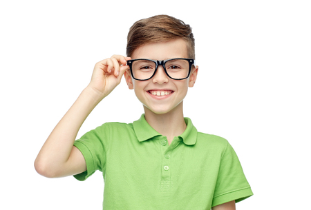 Photo for childhood, vision, school, education and people concept - happy smiling boy in green polo t-shirt in eyeglasses - Royalty Free Image