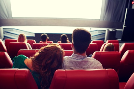 Photo pour cinema, entertainment, leisure and people concept - happy, couple watching movie in theater from back - image libre de droit